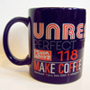 UNREST Perfect Teeth coffee mug and sticker