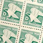 Green D stamp issued by the United States Postal Service